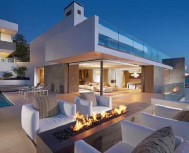 Luxury Terraces: 10 Outdoor Design Ideas With Fireplace design ideas with fireplace Luxury Terraces: 10 Outdoor Design Ideas With Fireplace Fireplace seaview 690x4601 371x300